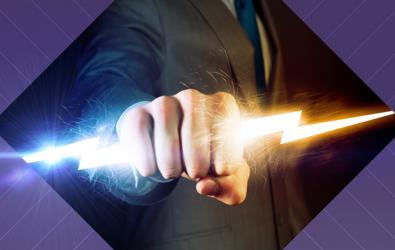 businessman grasping lightning bolt with fist